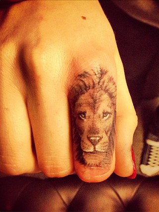 Cara Delevigne's lion tattoo, symbolising strength and her star sign Leo.