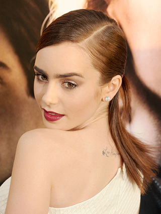 Lily Collins has a beautiful, subtle tattoo on her back, saying 'Love, always and forever' in her own handwriting.
