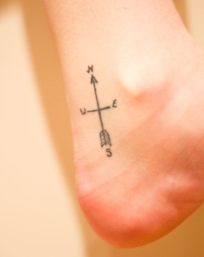 Lotty's lovely compass tattoo on her ankle