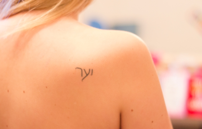 Hannah's last name in Hebrew on her back