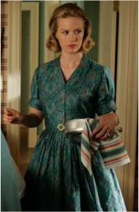 Looking like the perfect housewife in a blue paisley dress.