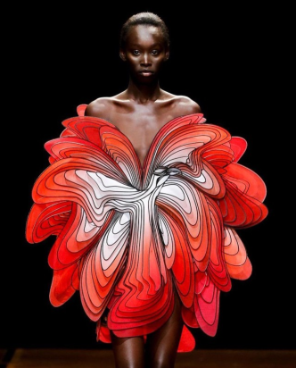 Iris Van Herpen. instagram.com/irisvanherpen/ The 'Symbiotic' dress.Gradient-dyed silk panels of red and white. Photo by @giostaiano at paris fashion week 2019.