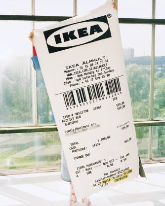 a-markerad-rug-shaped-like-a-giant-ikea-receipt-being-held-u-4fe96847b4b49c52059954cdb045260b